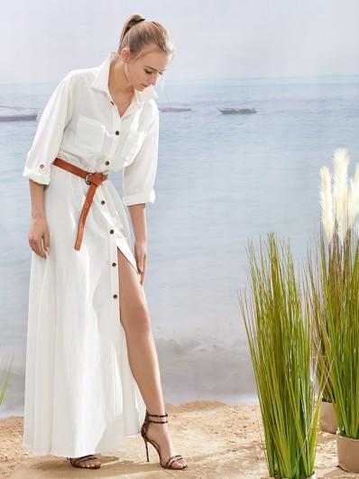 Elegancja i nonszalancja w jednym to sukienka w stylu safari, biała, długa , rozkloszowana Bee Collection Velma