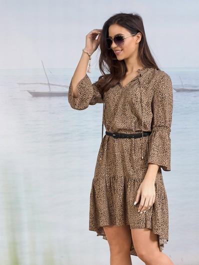 Modny, nowoczesny fason sukienki tuszującej brzuch i uda, luźna kobieca i ponadczasowa Bee Collection  Sahara