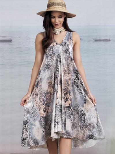 Szeroka sukienka na luzie, tuszująca na wesele w ogrodzie, na grilla i do pracy czy wieczór z przyjaciółmi Bee Collection Malta